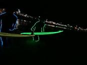 Surf nocturne avec combi board néons Bondi beach