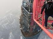 Escalade l'arrache d'une tour plein Shangai